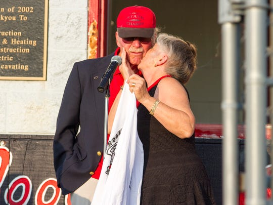 Sandra Roberts kisses her husband Wayne Roberts, during a ceremony dedicating the track at Sandusky High School to him Aug. 25. Roberts, who began coaching cross country in 1976 and continued until he took a 10 year retirement in 2000, was involved in a hit-and-run accident last fall that left him with a traumatic head injury, ending his 13,446 day running streak.