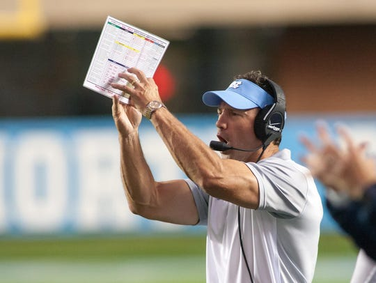 North Carolina Tar Heels head coach Larry Fedora signals