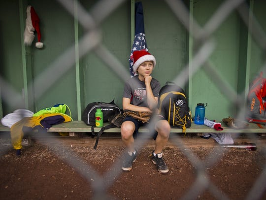 Nolan Simon waits for his turn at bat during a community Christmas-Eve baseball game at Callahan Park in December 2015. Temperatures were climbing over 60 degrees as players took the field, many wearing shorts and T-shirts.