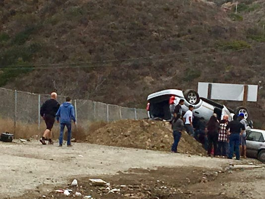 Overturned car on Conejo Grade