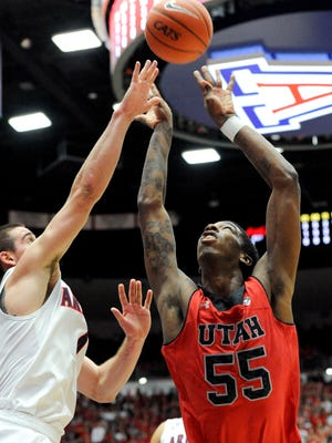 Jan 26, 2014; Tucson; Utah Utes guard Delon Wright (55) and Arizona Wildcats guard T.J. McConnell (4) battle for the rebound during the first half at McKale Center. Mandatory Credit: Casey Sapio-USA TODAY Sports