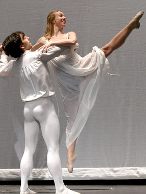 """Ethan Michael Lee and Mary Elizabeth Fenn of Neos Dance Theatre perform a scene from """"The Nutcracker"""" on Monday."""