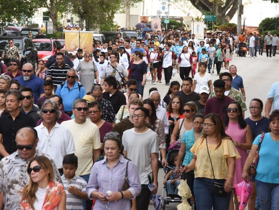 In this Dec. 8, 2016, file photo, Catholic faithful and others proceed through the streets of Hagåtña during the annual celebration of the Immaculate Conception of the Blessed Virgin Mary.