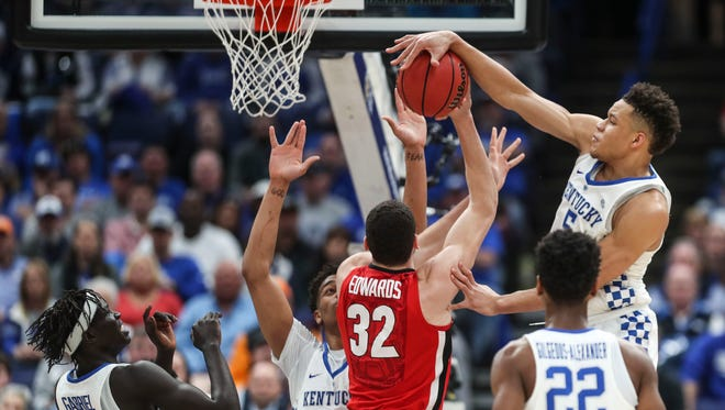 Kentucky's Kevin Knox gets a block against Georgia Friday afternoon in the 2018 SEC Tournament at the Scotttrade Center in St. Louis.
