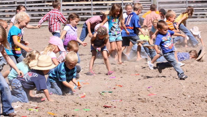 Kids attending the Choteau Ranch Rodeo race after candy bars during a break in the competitive cattle-working event at the Choteau Rodeo Grounds. This year's event takes place Saturday, Sept. 2 starting at noon.