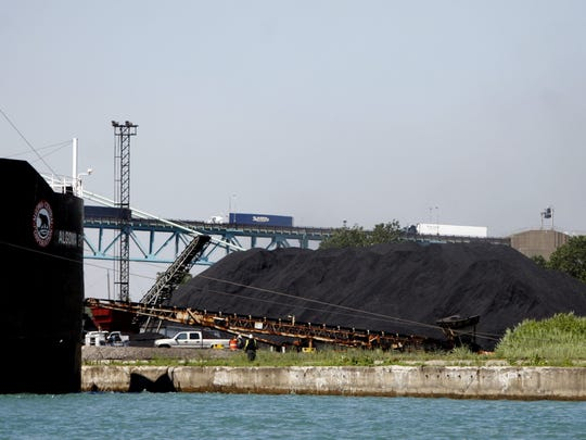 A freighter loads up pet coke along the along the Detroit