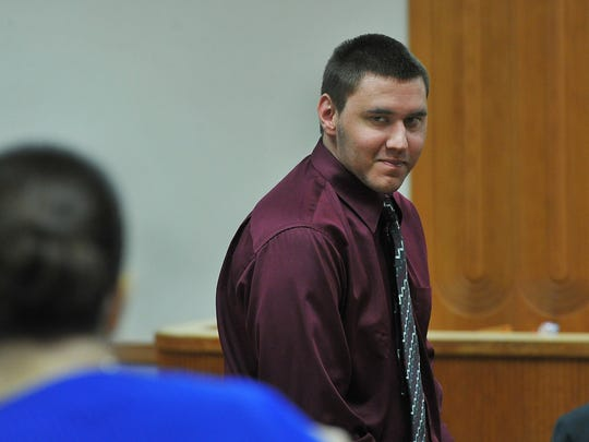 Tyler Hadley smiles at his family while exiting the courtroom during his sentencing hearing in March 2014. (FILE PHOTO)