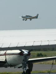 A single-engine prop plane arrives at Ocean County