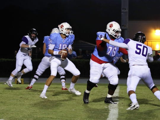 USJ's Jacob Buie drops back to pass against TCA on