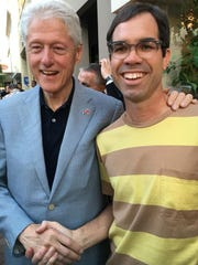 Aaron Gomes and Bill Clinton shake hands outside of