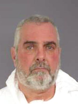 John Towey, a former Belleville police lieutenant, was accused of shooting his brother in Towey's Nutley home on Race Street.