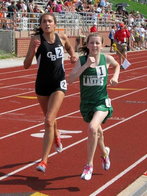 Grand Blanc's Gabrielle Anzalone (left) won her only state championship after six top-five finishes in a 3,200-meter duel with West Bloomfield's Erin Finn (right) in the 2011 state Division 1 track and field meet.