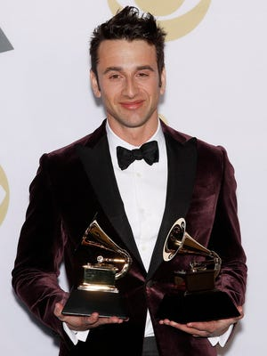 Justin Hurwitz poses in the press room with the Grammys for Best Score Soundtrack for Visual Media and Best Compilation Soundtrack for Visual Media during the 60th annual Grammy Awards ceremony at Madison Square Garden in New York.