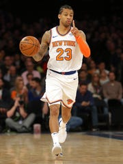 New York Knicks point guard Trey Burke (23) brings the ball up court against the Chicago Bulls during the first quarter at Madison Square Garden.
