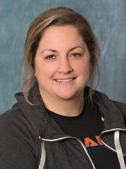 Jennifer Cottrill, who guided Novi to three Class A
