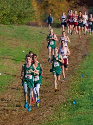 Nashoba's Freddy Collins (front) and Ailin Oberlies lead the field during last year's Mid-Wach B championshion.
