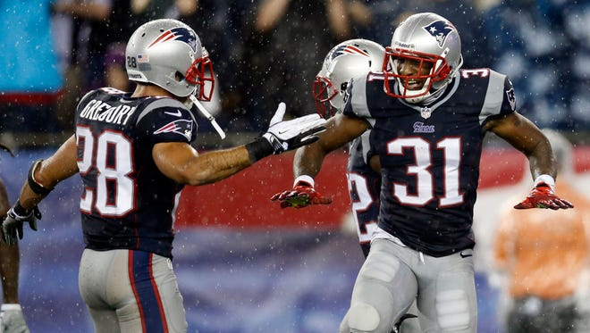 New England Patriots cornerback Aqib Talib (31) celebrates with strong safety Steve Gregory (28) after an interception during the fourth quarter against the New York Jets at Gillette Stadium.