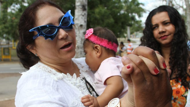 Dr. Alba Batista, a neurologist who heads the specialized microcephaly clinic at Pedro I, holds a child with microcephaly at a city-run picnic held for families whose children suffer from Zika-related illnesses.