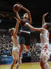 Grinnell's  Sienna Durr, 35, goes for two of her 23 points in the Class 4A   69-48 championship game loss to Marion.Durr was named to the all-tourney team.