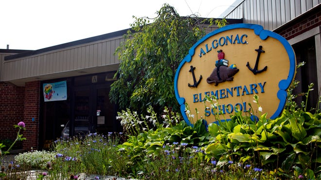 A sign marks the entrance Algonac Elementary School. District officials are considering consolidation, which would close two schools and could save the district between $600,000 to $800,000, Superintendent John Stryker said.