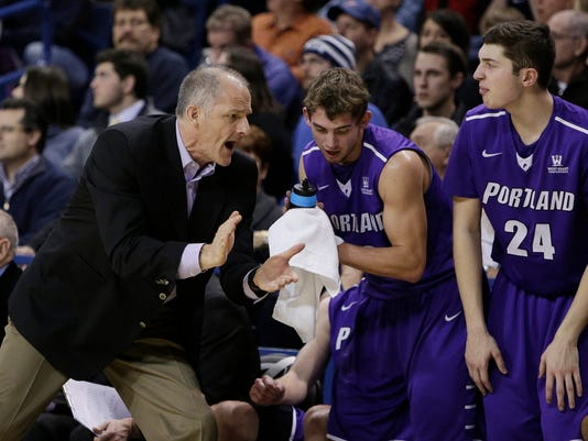 Portland head coach Eric Reveno encourages his team during the first half of an NCAA college basketball game against Gonzaga, Thursday, Jan. 29, 2015, in Spokane, Wash. (AP Photo/Young Kwak)