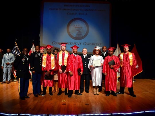 Delaware students who have dropped out of high school or are at risk of dropping out can get their high school diploma from the Capital Guardian Youth ChalleNGe Academy in Maryland. In this picture, Delaware's first class in the program graduates. Left to right: MAJ Reginald Jones, COL Angela Showell, Cadet Randy Alexander, Cadet Dreamon McIntosh, Mrs. Karen Hughes, Cadet Zachary Whitaker, Cadet Jim McCants, GEN Francis Vavala, Cadet Daimiayza Eley, BG David Fleming, Cadet Joshua Ferrell, Cadet Benjamin Ekas