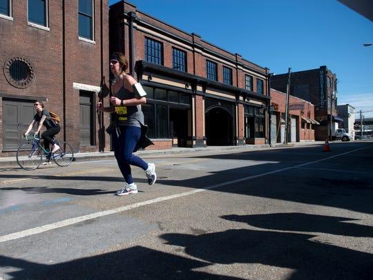Kristin Seabrook runs along Jackson Ave. during the