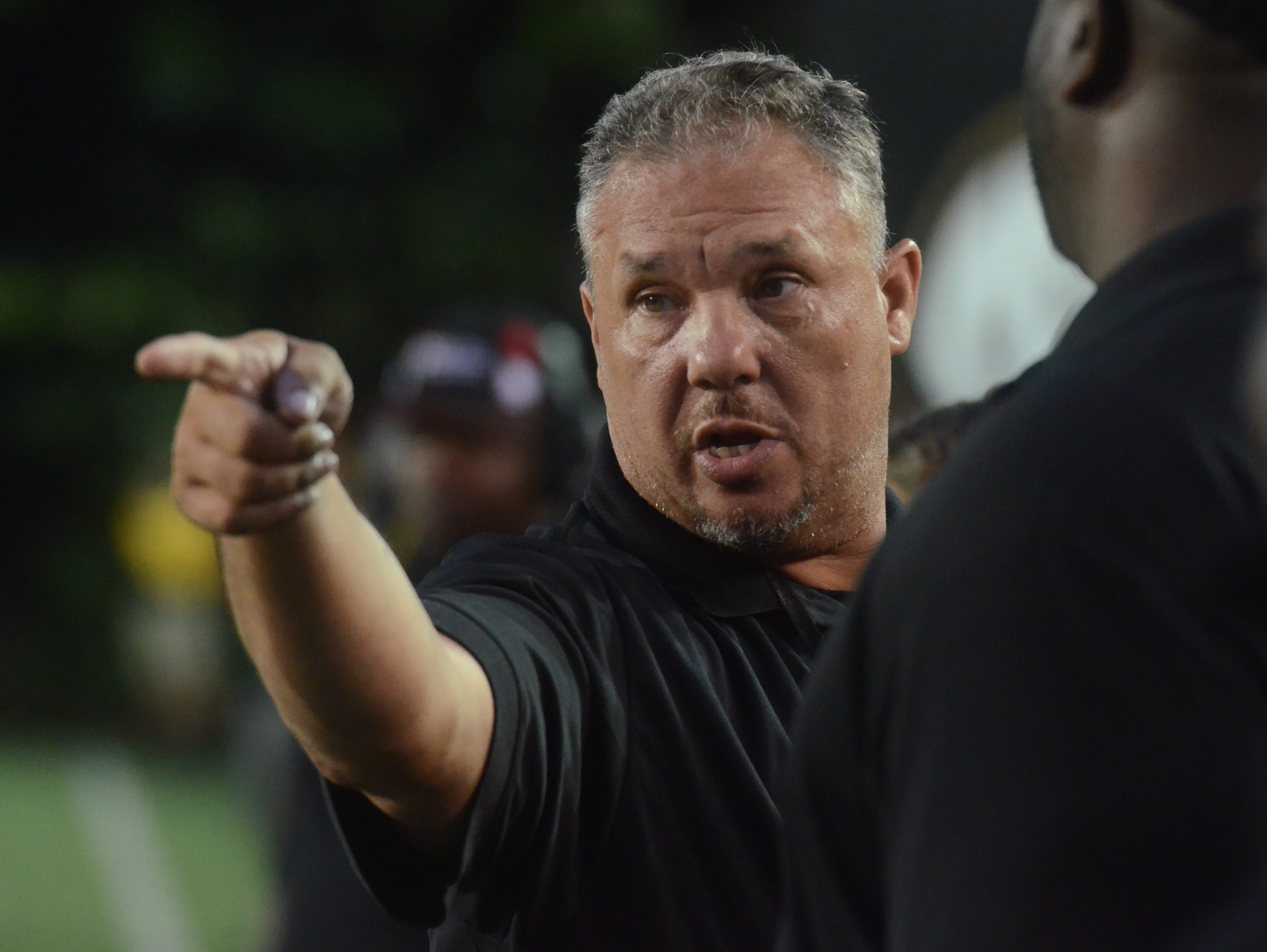 Pearl-Cohn coach Tony Brunetti gives instructions during Saturday's game against Hillsboro.