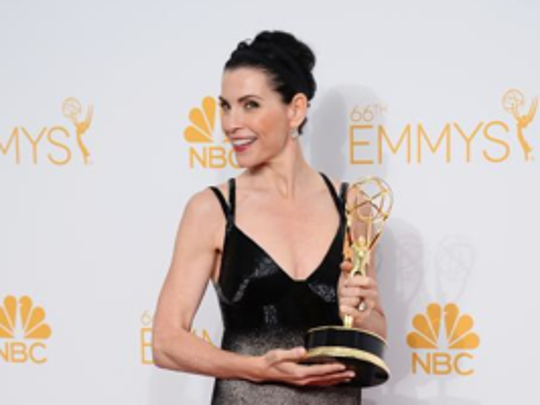 Julianna Margulies poses with the award for Outstanding Lead Actress in a Drama Series Award in the press room at the 66th Annual Primetime Emmy Awards at the Nokia Theatre L.A. Live on Monday, Aug. 25, 2014, in Los Angeles.