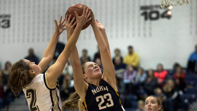 Point Pleasant Boro's Allie Delaney and Toms River North's Jenna Paul battle for ball. Toms River North Girls Basketball vs Point Pleasant Boro in WOBM Christmas Classic Final.