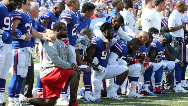 Players from both teams took a knee during the national anthem in response to President Trumps remarks.