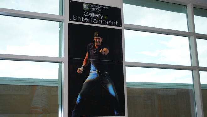 Don't be surprised if you bump into, from left, Luke Bryan, Jon Bon Jovi or Zac Brown the next time you're in the concourse of the Resch Center. The super-sized photos of the A-list acts are part of the new Press-Gazette Media Gallery of Entertainment at the arena.