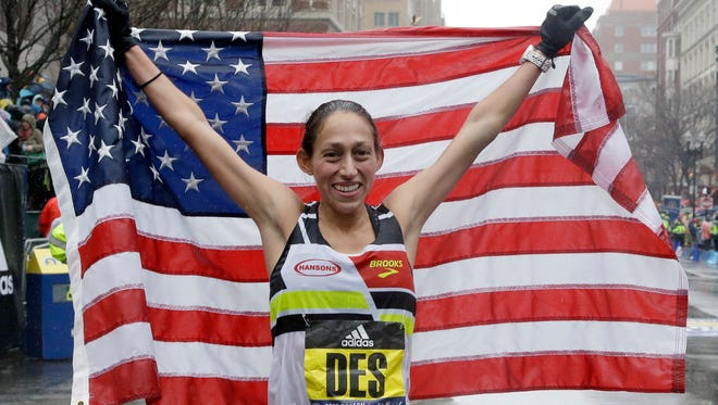 Desiree Linden celebrates after winning the women's division of the 122nd Boston Marathon on Monday, April 16. She is the first American woman to win the race since 1985.