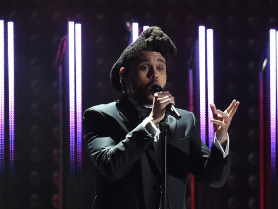 The Weeknd performs during the 58th Grammy Awards.