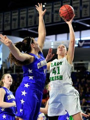 Houston County's Breanna Boggs, right, puts up a shot