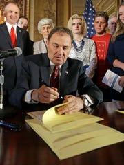 Utah Gov. Gary Herbert signs a bill in Salt Lake City in this file photo from April 19, 2016.