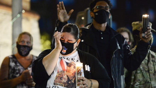 Felicia Damon, weeps and Amarri Reid, during a vigil for U.S. Army Sgt. Elder Fernandes, 23, at Brockton City Hall on Friday, Aug. 28, 2020.  Sergeant Fernandes was a 2015 graduate of Brockton High School, who was assigned to the 1st Cavalry Division Sustainment Brigade, went missing  from Fort Hood in Texas on Aug. 17. He was found dead in Temple, Texas, on Tuesday, Aug. 25, 2020.