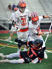 York Suburban's Bryce Gavin is bumped to the ground by Central York's Jesse Behler (30) and Connor Hoch (30). BIL BOWDEN -- For The York Dispatch
