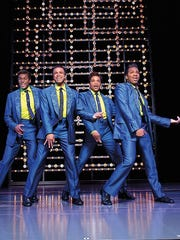 Cast members perform as the Drifters, one of the many