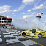 Matt Kenseth celebrates with a burnout after winning the Sprint Cup Series Windows 10 400 on Sunday at Pocono Raceway in Long Pond, Pa.