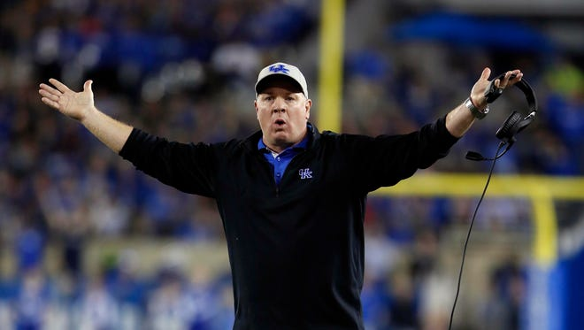 Kentucky Wildcats head coach Mark Stoops reacts during the game against the Auburn Tigers in the first half at Commonwealth Stadium.