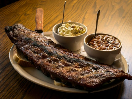 Wobbly Boots Roadhouse full rack of dry-rubbed ribs with baked beans and potato salad.