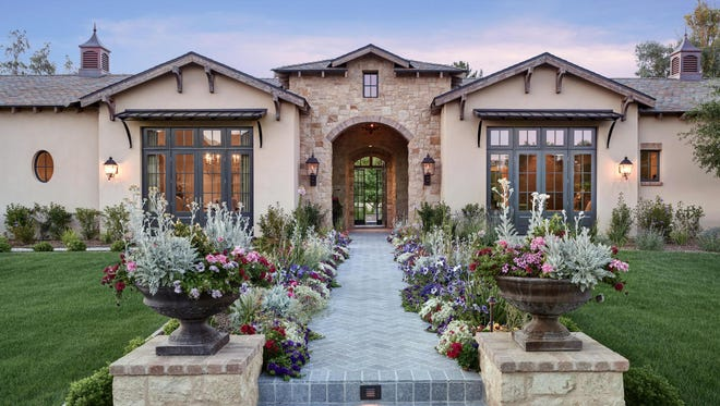 Leslie and Diane Del Corieri, owners of Evening Entertainment Group,purchased this 6,451-square-foot mansion in Paradise Valley's Equestrian Trails community.