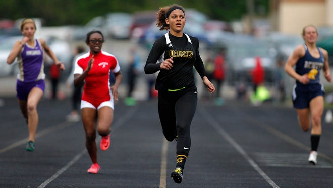 Waverly's Priscilla Trainor wins the 200-meter dash during the MHSAA Division 2 track regionals Friday, May 19, 2017, in Williamston, Mich.