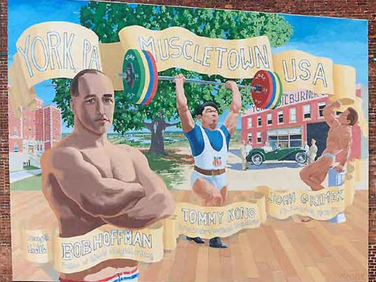 The Muscletown USA mural is displayed at 37 W. Philadelphia St. in York. From left, it shows York Barbell Co. founder Bob Hoffman; Tommy Kono, who medaled in three Olympic weight classes; and York's John Grimek, who won the first two Mr. America bodybuilding events in 1940-41.