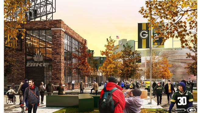 An artist's conceptual rendering shows a fall scene in the Titletown District public plaza with Lambeau Field in the background. Final designs might differ.
