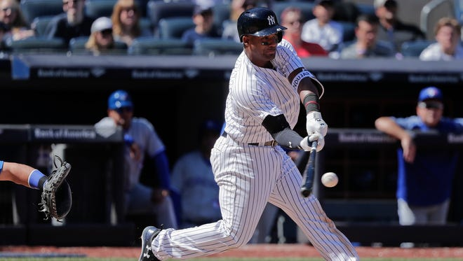 New York Yankees third baseman Miguel Andujar connects for a three-run double against the Toronto Blue Jays during the sixth inning of a baseball game, Saturday, April 21, 2018, in New York.