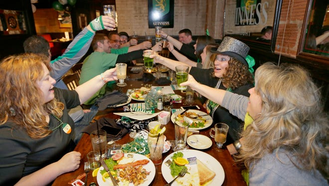 People hit Milwaukee area pubs as early as 6 a.m. to celebrate St. Patrick's Day.