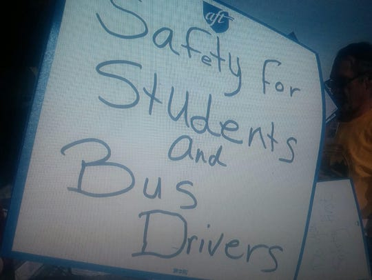 """""""Safety for Students and Bus Drivers,"""" reads a sign"""