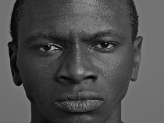 "Claude Mumbere, a Burlington High School alumnus and winner of Vermont's Poetry Out Loud competition, is among the subjects of ""Todd R. Lockwood: Portraiture Reimagined"" at Champlain College."
